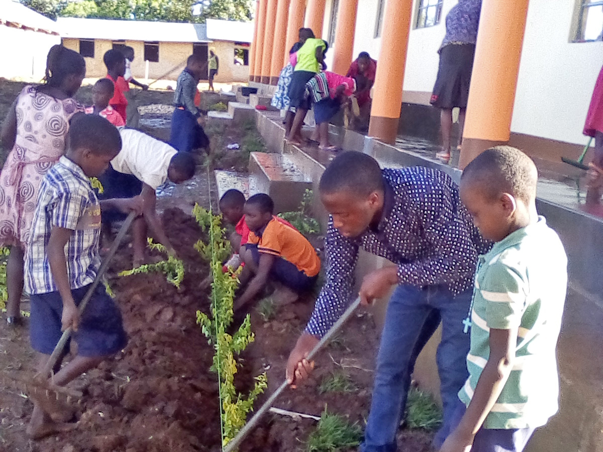 - Students work on landscaping