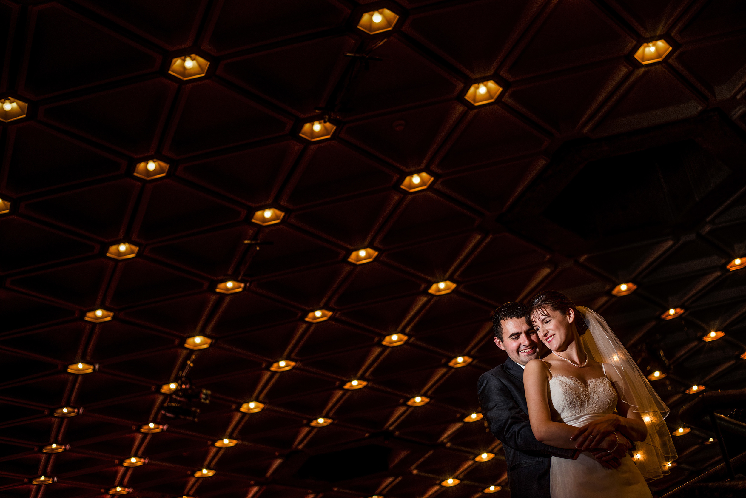 bride and groom hug after a wedding ceremony at the national arts centre ottawa
