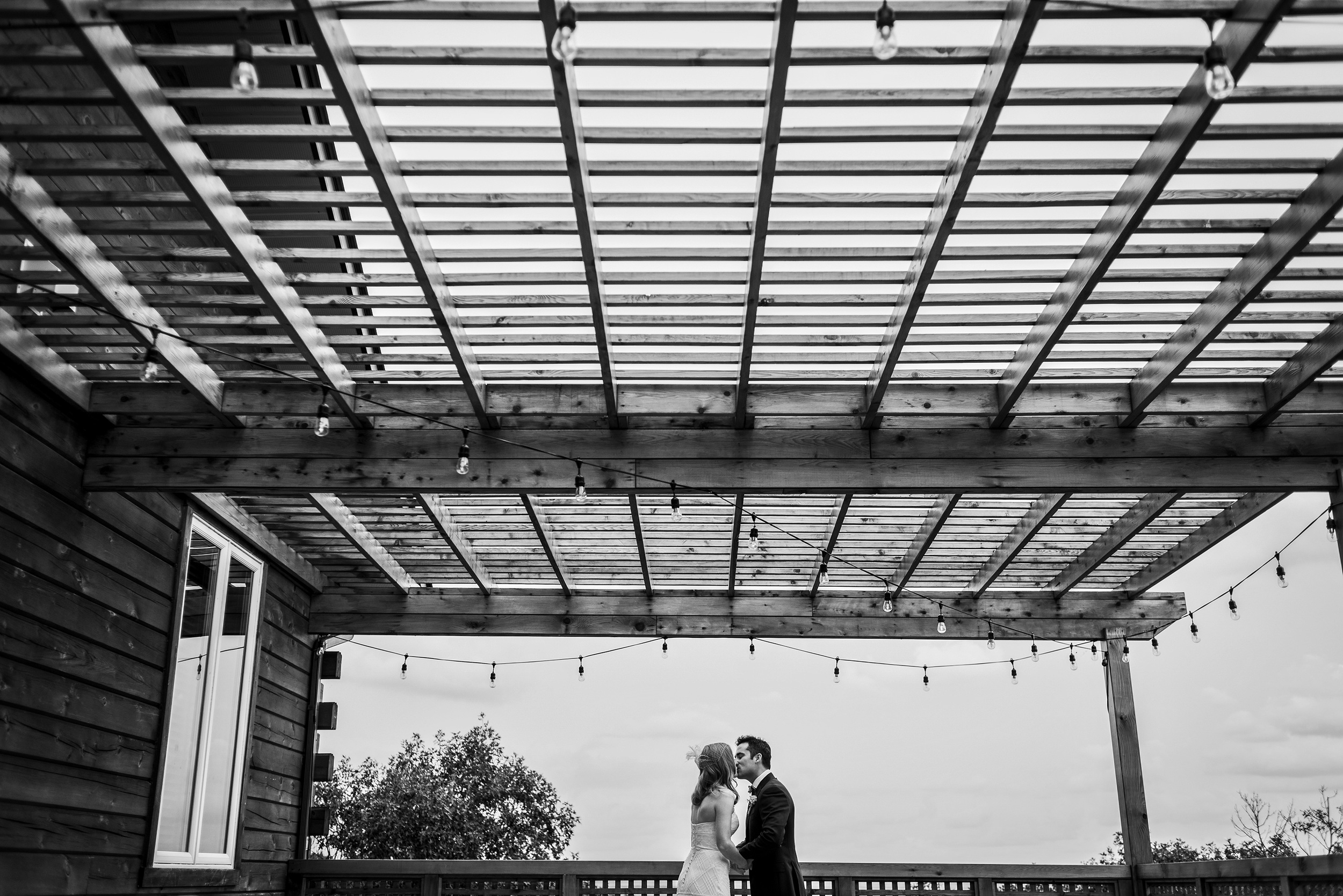 bride and groom kiss on patio les fourgeres wedding in quebec