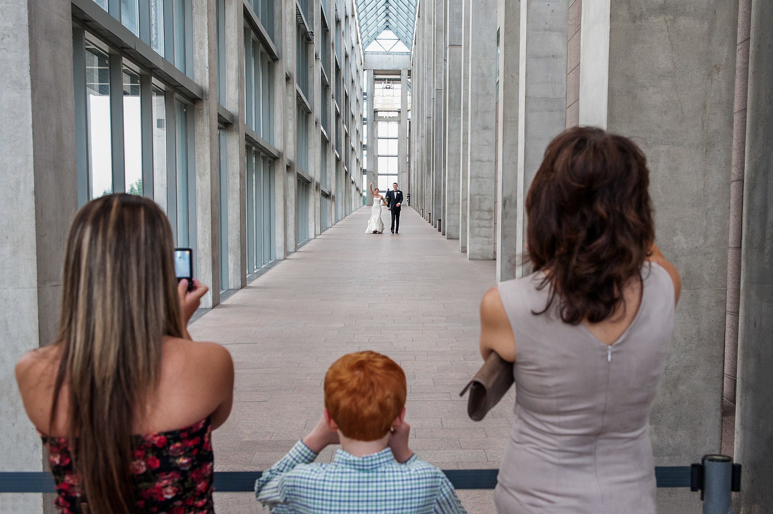 bride groom about to greet guests at national gallery of canada wedding