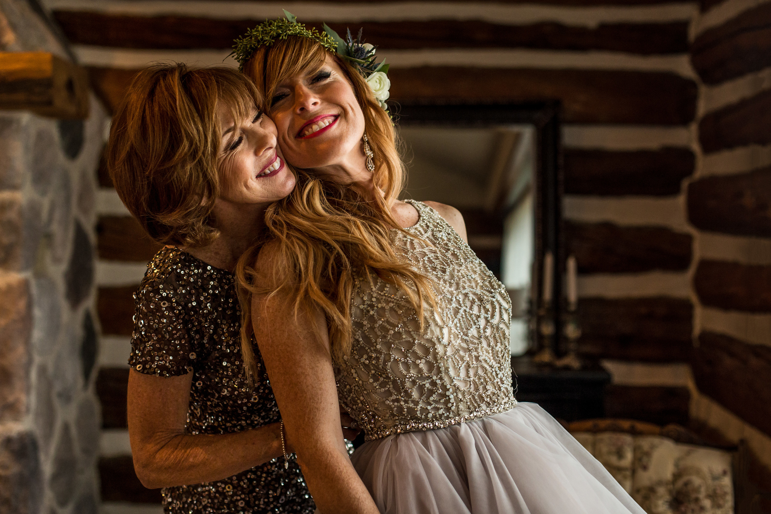 bride mother hugs bride before wedding ceremony at a stonefields wedding in carelton place ontario
