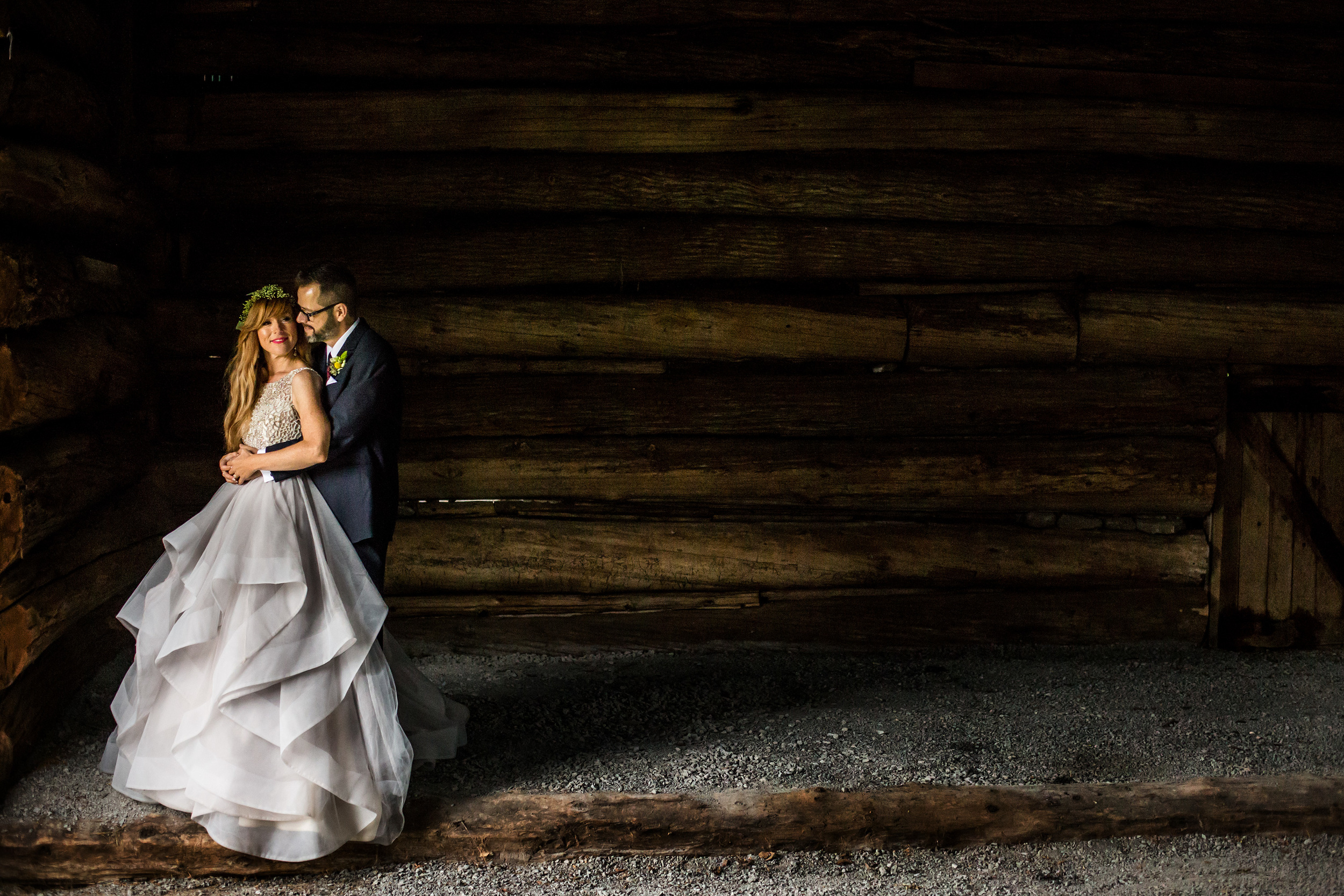 Bride with a beautiful wedding dress in a barn with her groom at Stonefields in Ottawa