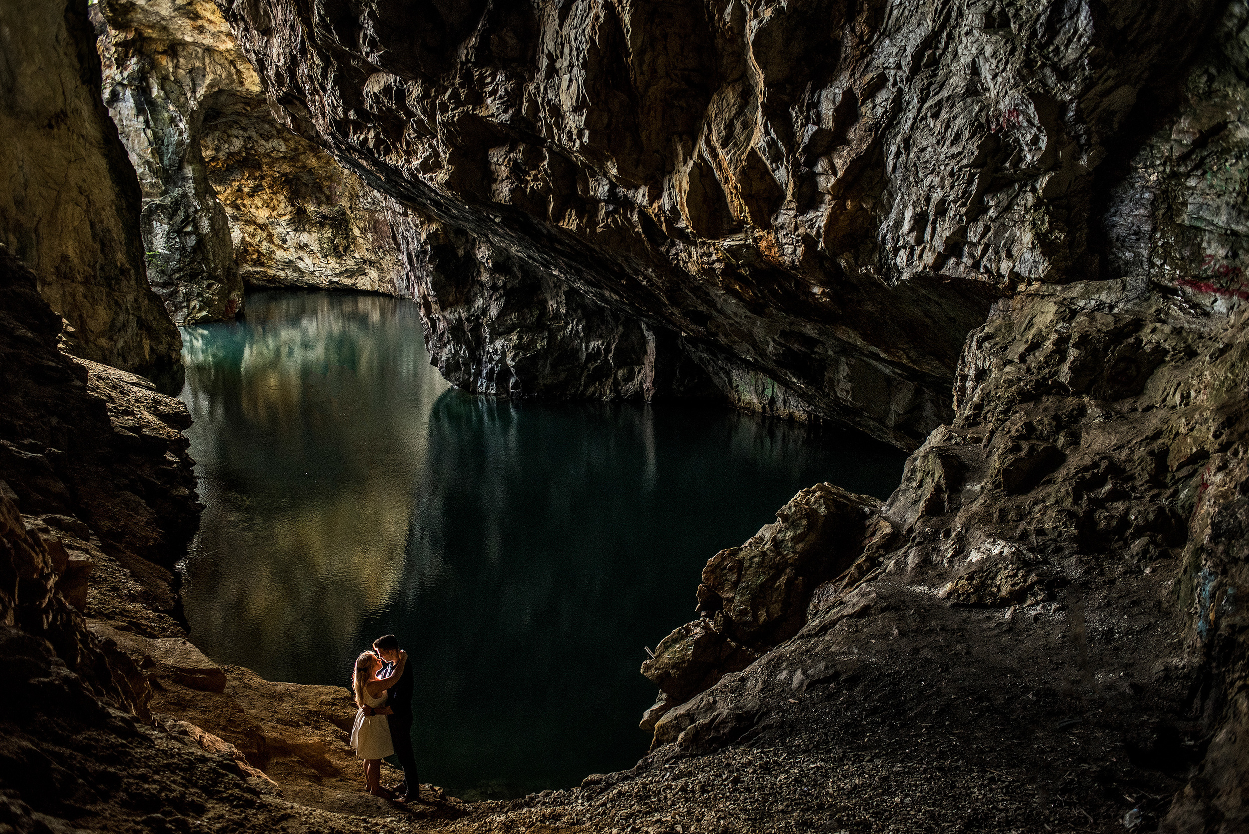a couple having an engagement portrait in a cave