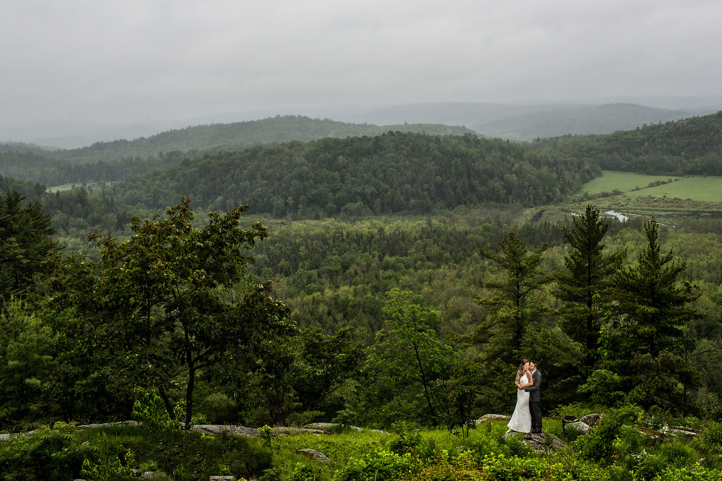 bride and groom pose for a portrait at a le belvedere wedding with wakefield valley in the background