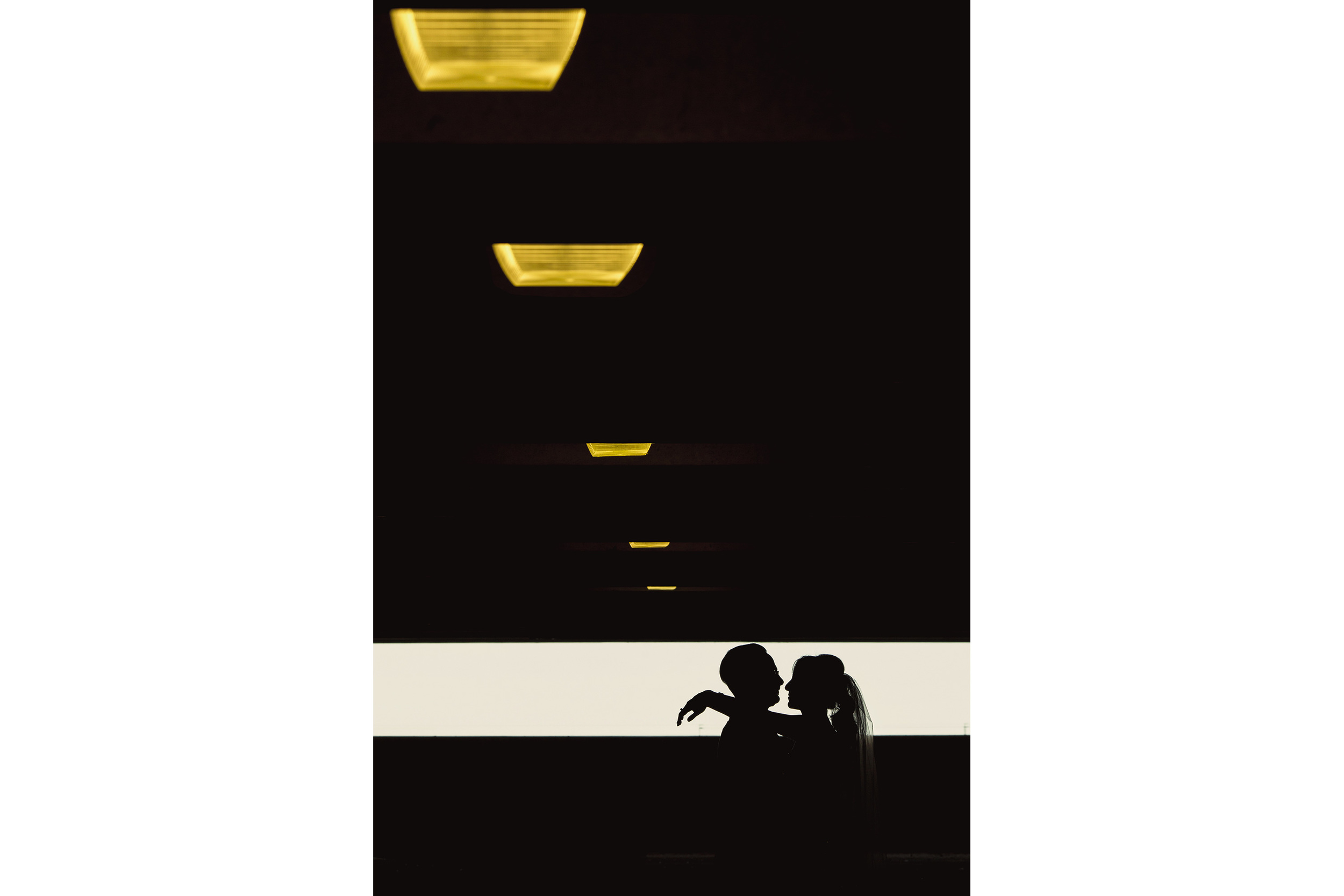 bride and groom silhouette in a parking garage at brookstreet hotel