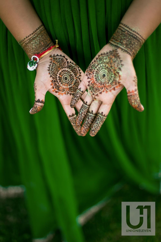 henna on an indian brides hands