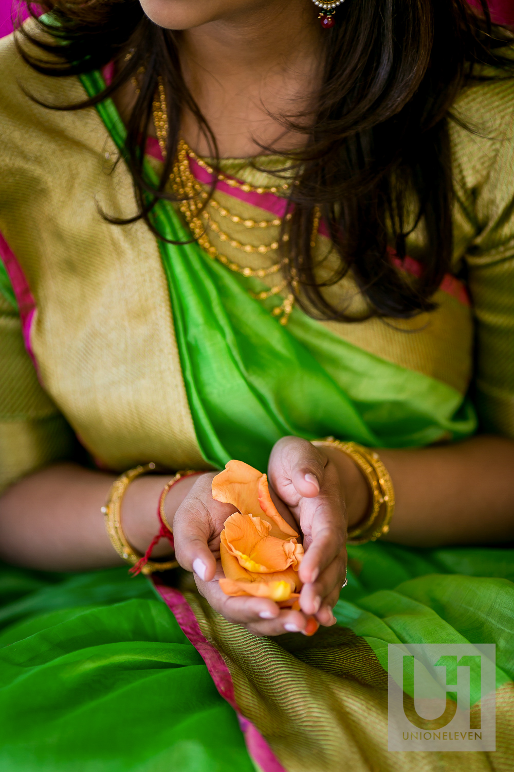 indian bride holding flower petals at a hindu ceremony