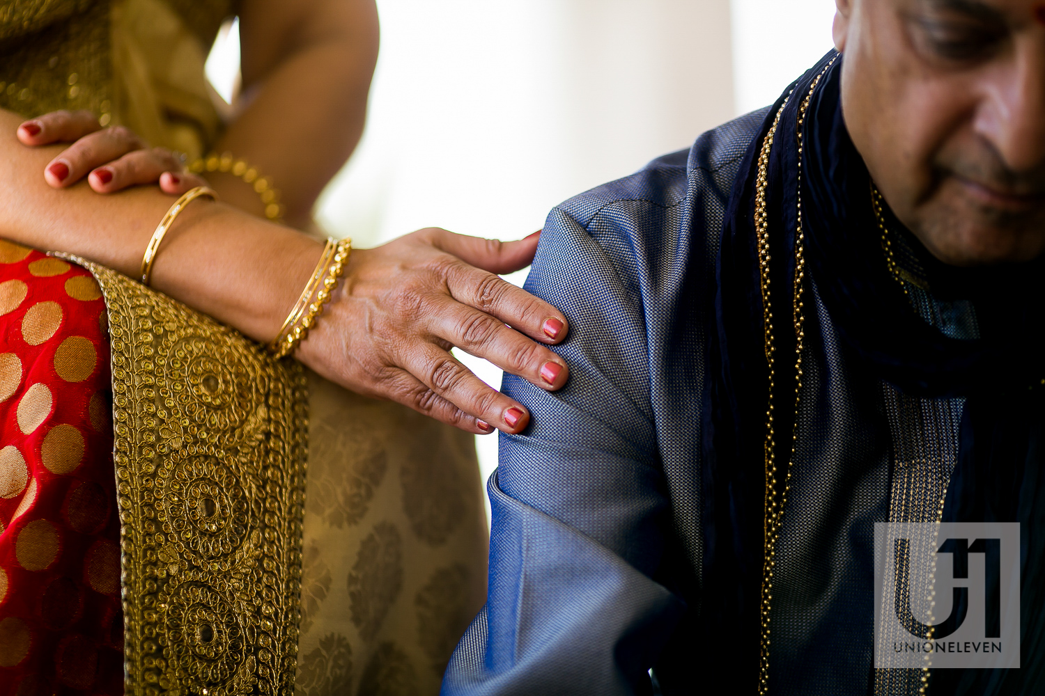 indian brides mother and father at a mendhi ceremony