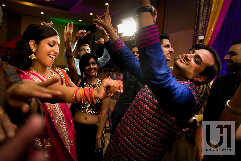 hindu bride and groom dancing