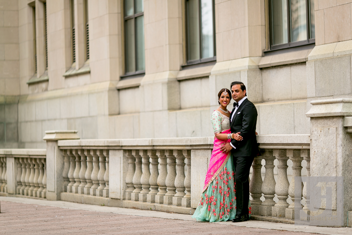 indian couple outside of the chateau laurier on their wedding day