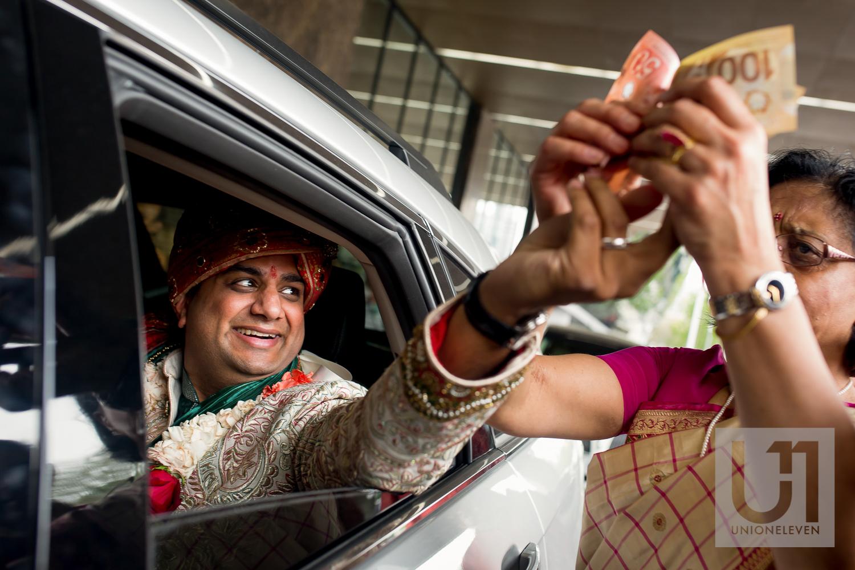 indian groom leaving his wedding ceremony