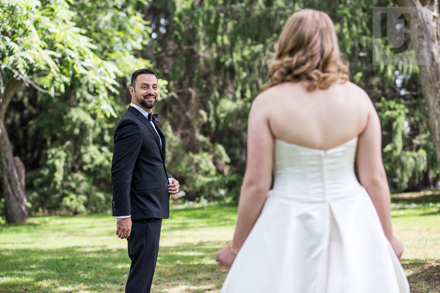 groom-turning-to-face-bride-in-gown-for-first-look-prior-to-wedding-in-ottawa