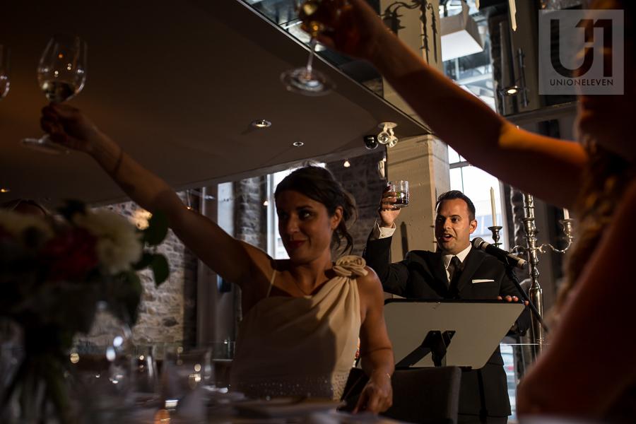 groomsman-toasting-after-speech-during-wedding-reception-at-eighteen-restaurant-in-ottawa