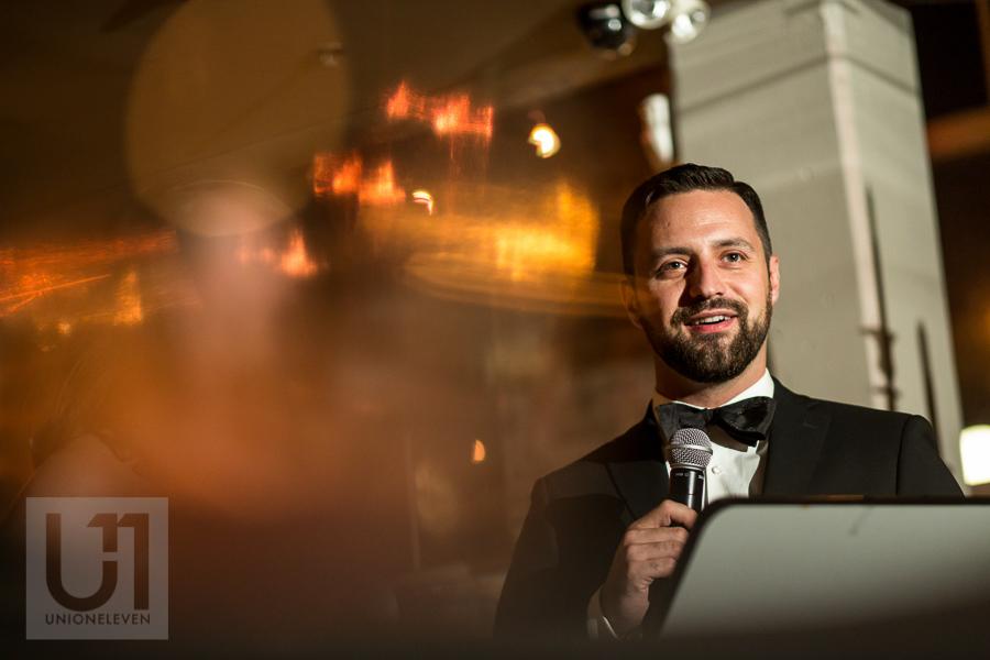 portrait-of-groom-giving-speech-during-wedding-reception-at-eighteen-restaurant-in-ottawa