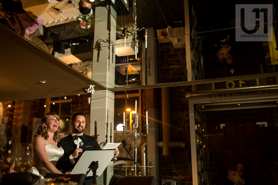 bride-and-groom-giving-speech-during-wedding-reception-at-eighteen-restaurant-in-ottawa