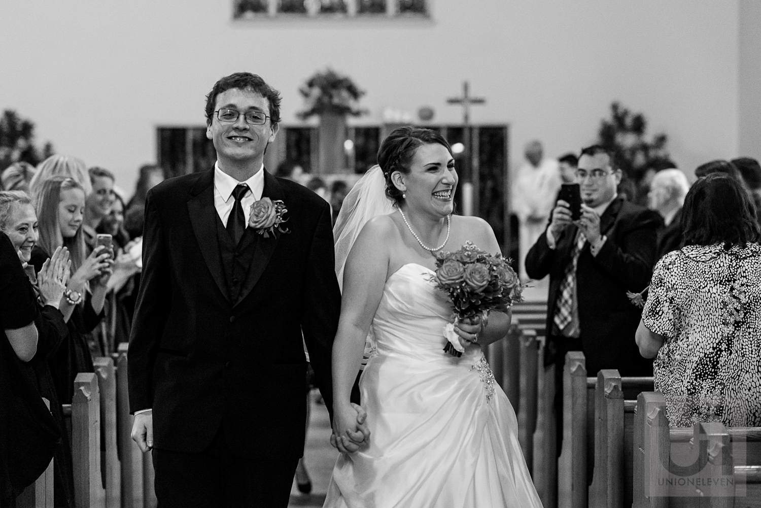 The bride and groom walking down the aisle as husband and wife