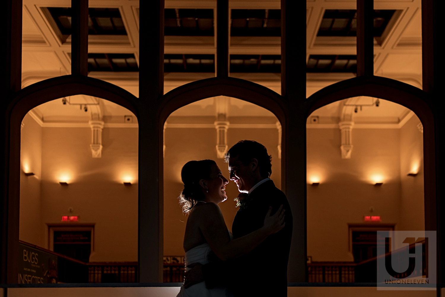 A silhouette photo of the bride and groom during their wedding reception at the Museum of Nature, Ottawa.