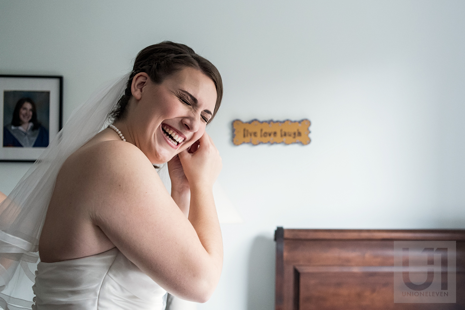The bride getting ready and trying on her earrings