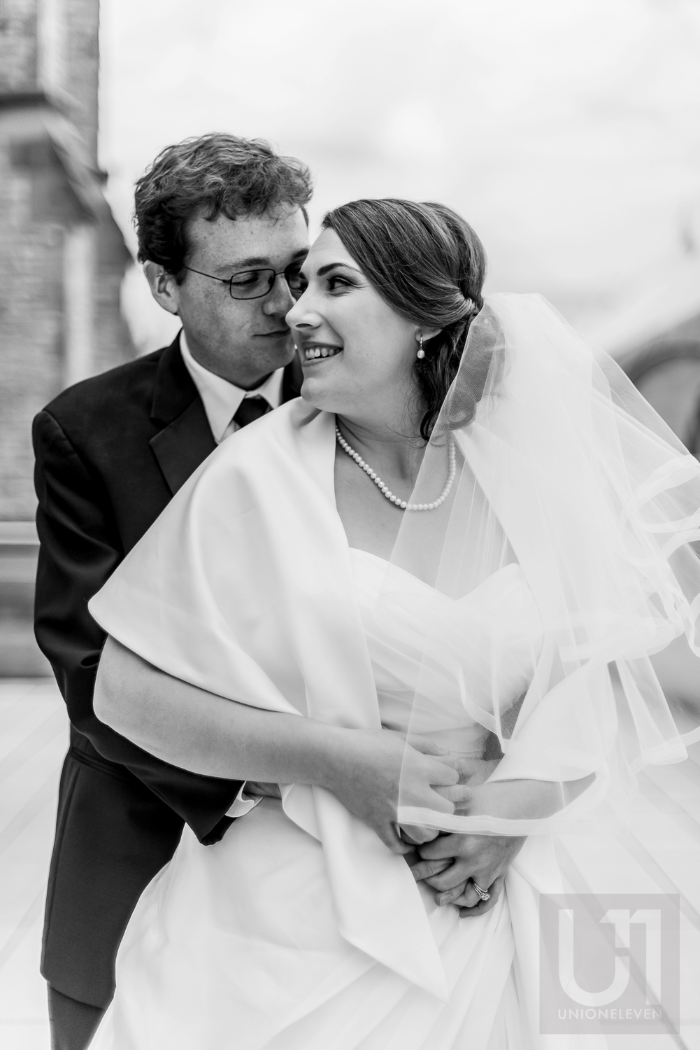 A black and white photo of the bride and groom outside their wedding reception at The Museum of Nature, Ottawa.