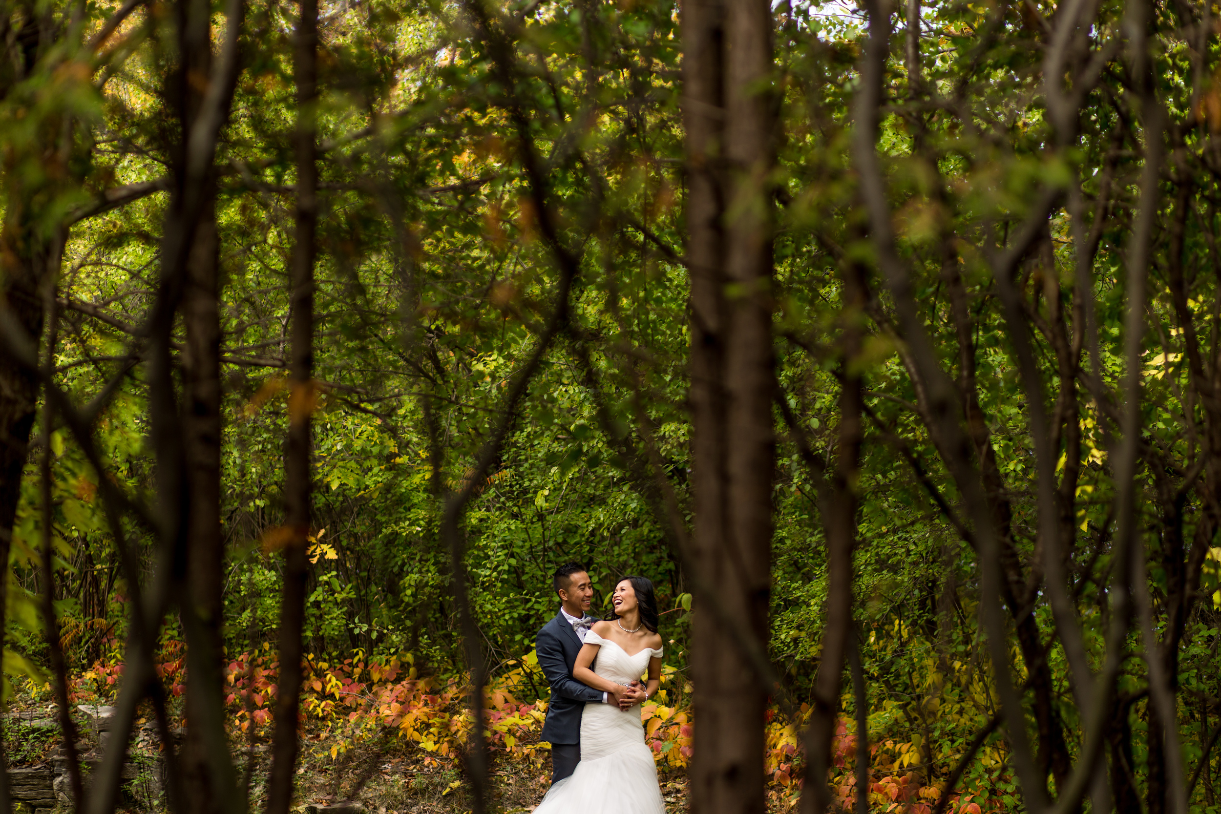 Photo of the bride and groom together outside in the forest