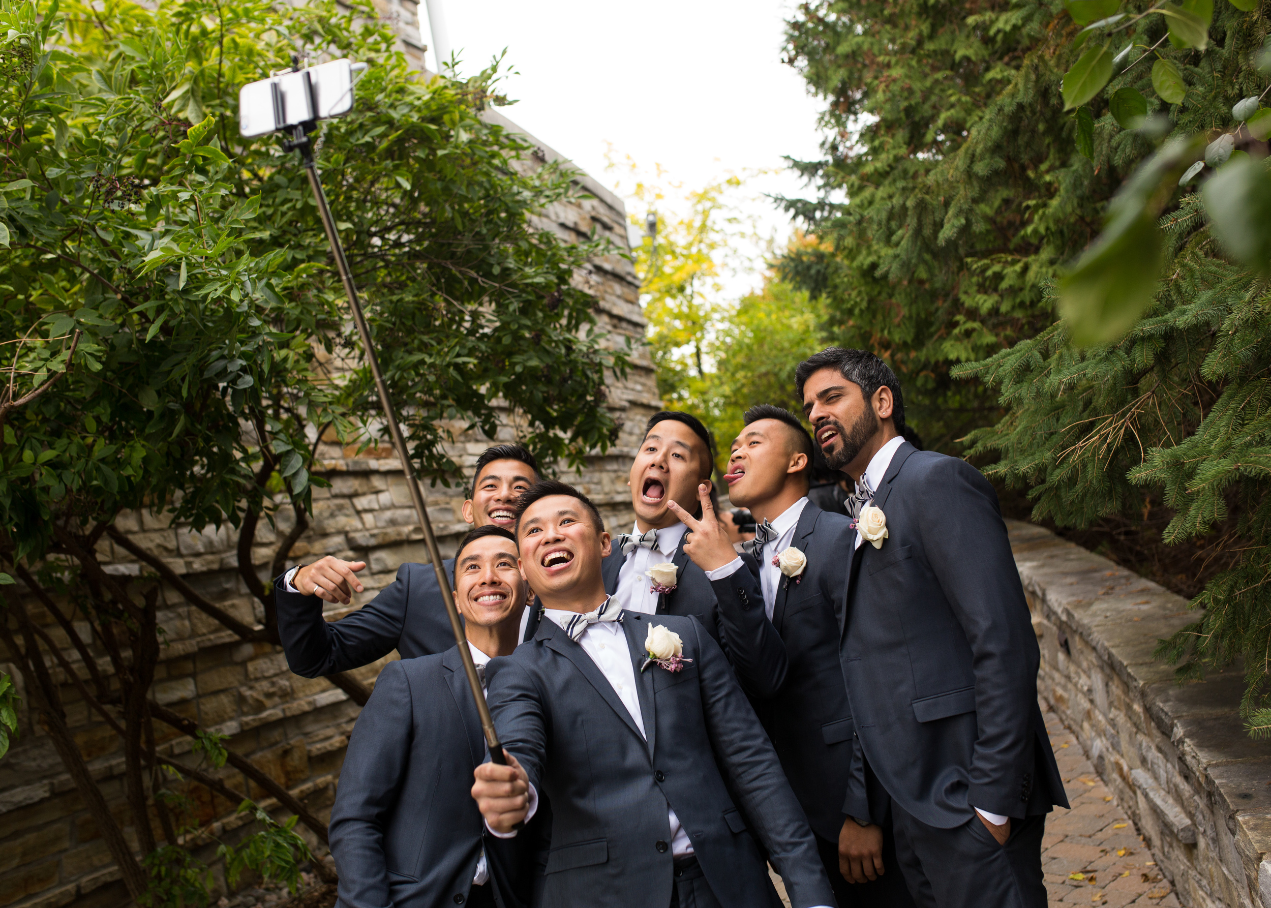 A photo of the groom and his groomsmen taking a selfie