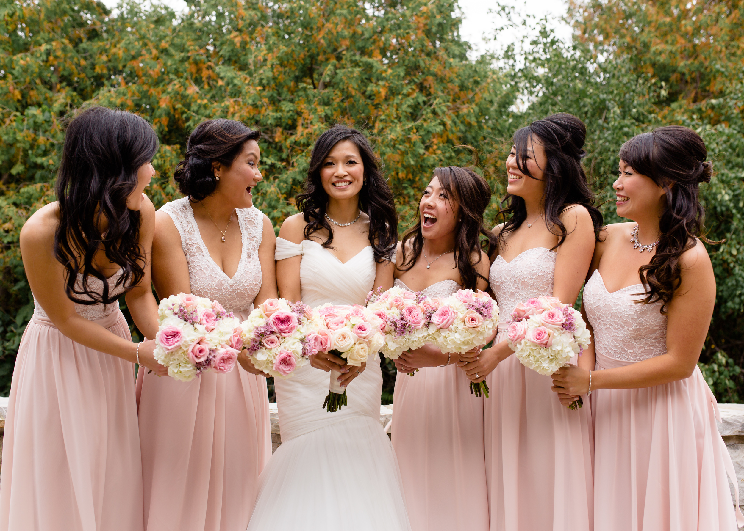 An outdoor photo of the bride and her bridesmaids
