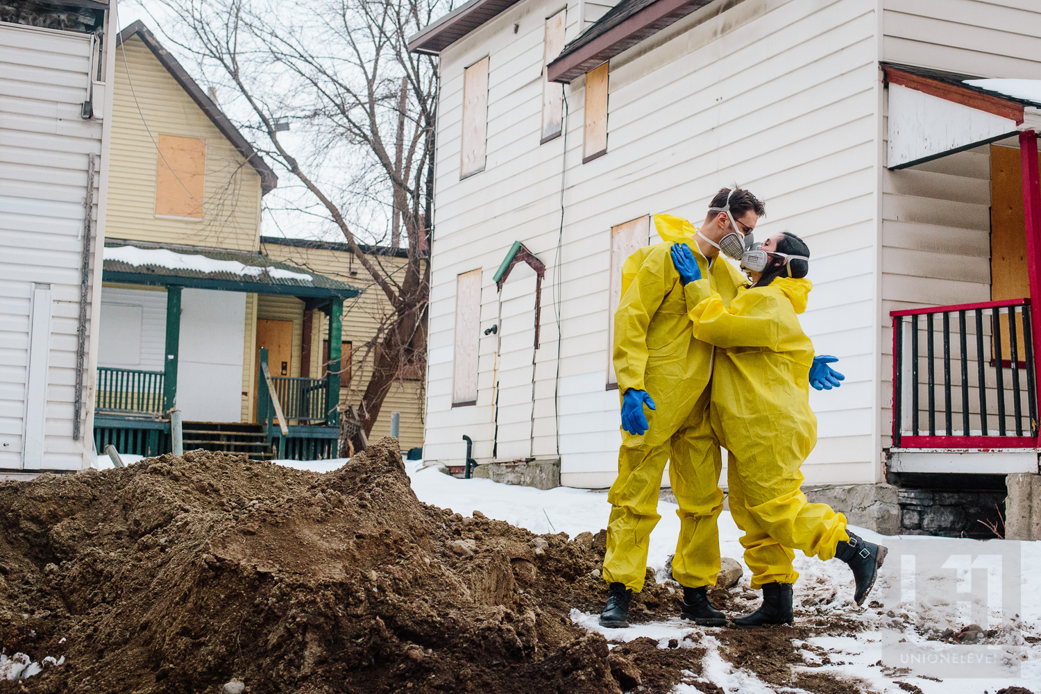 Engagement shoot with the couple hugging in their hazmat suits