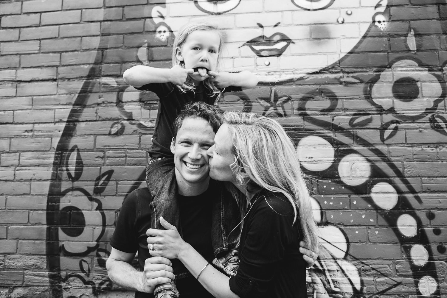 black and white photo of a couple in Ottawa with their daughter