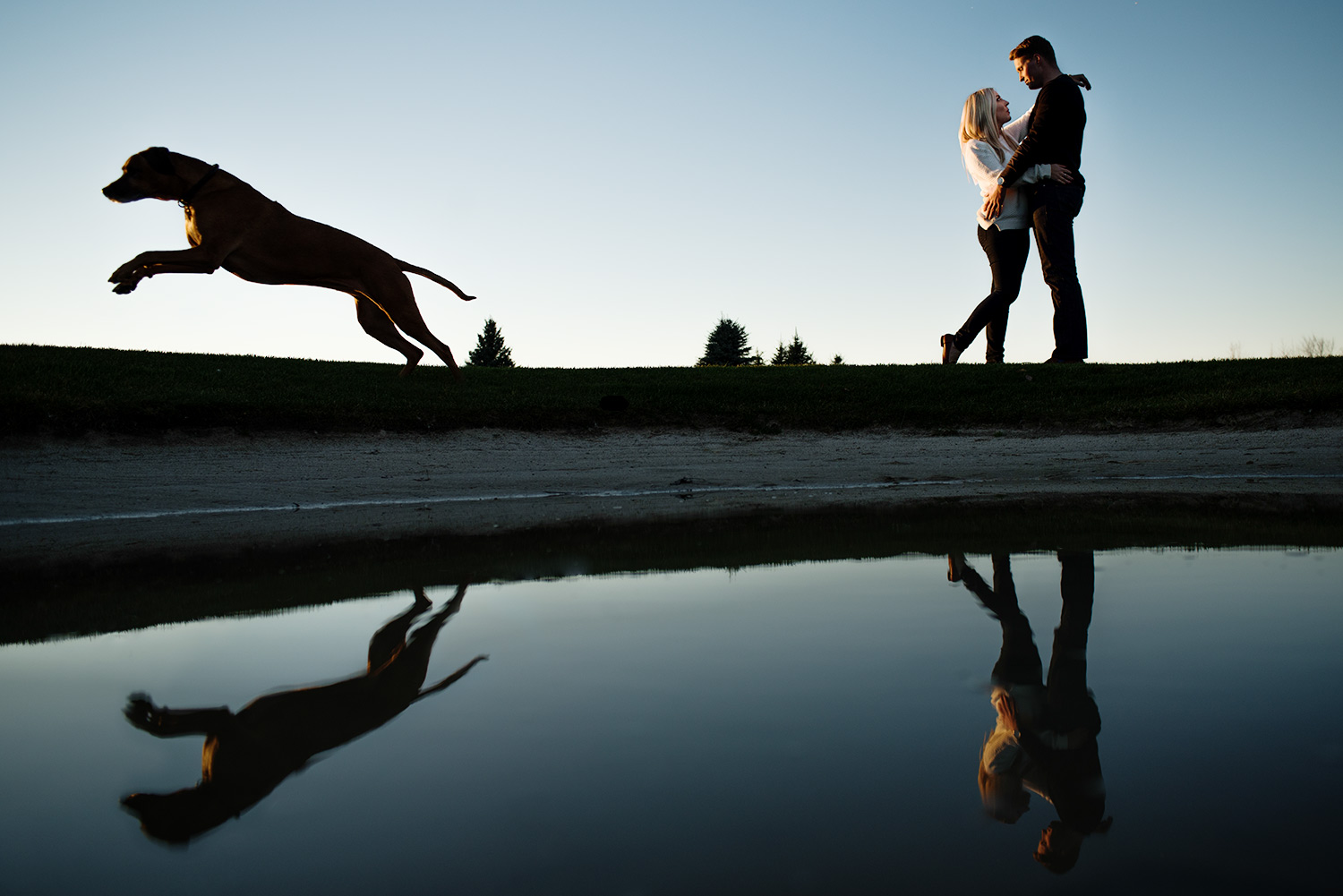 couple with reflection with dog
