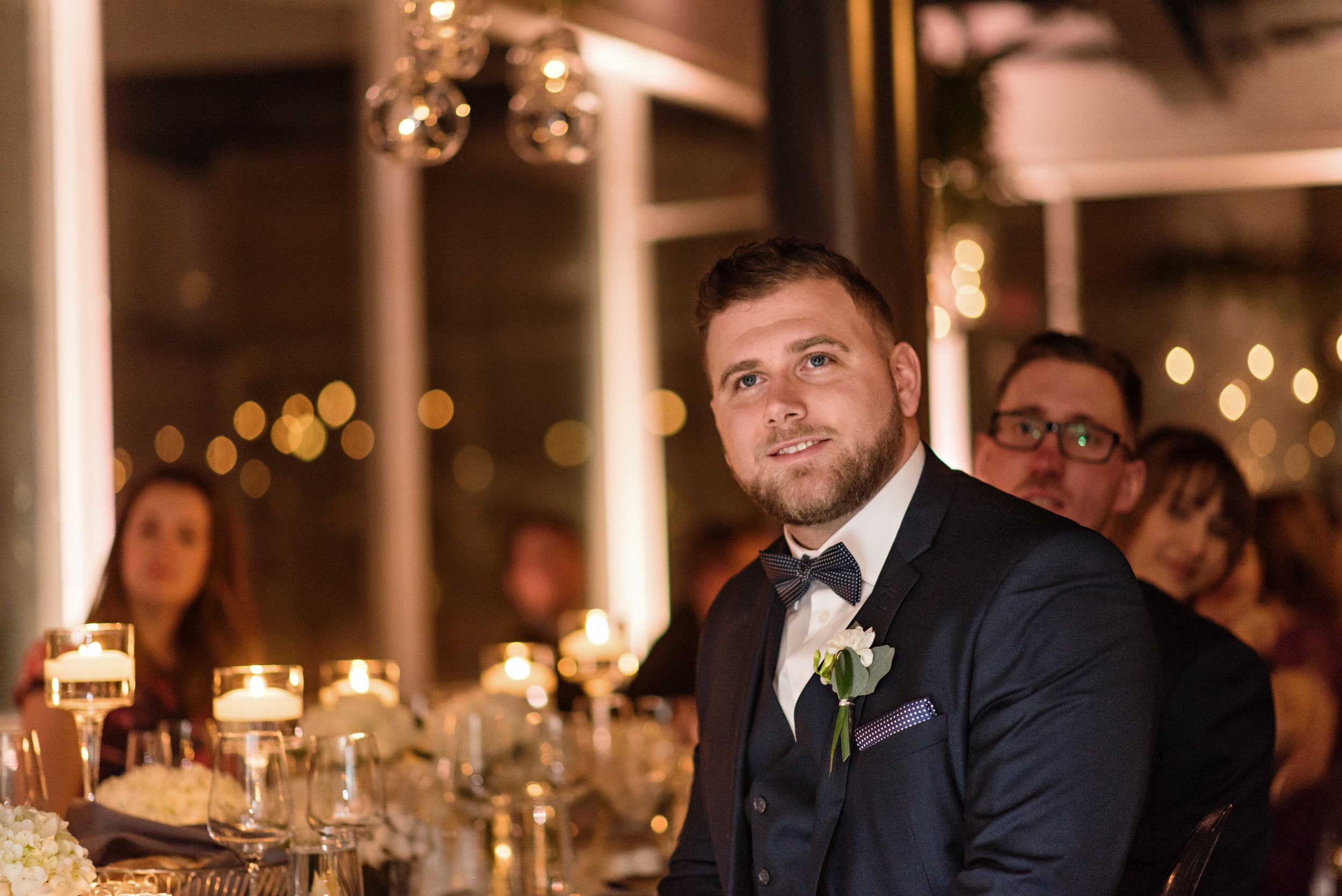 A photo of the brides brother during her speech at the wedding reception