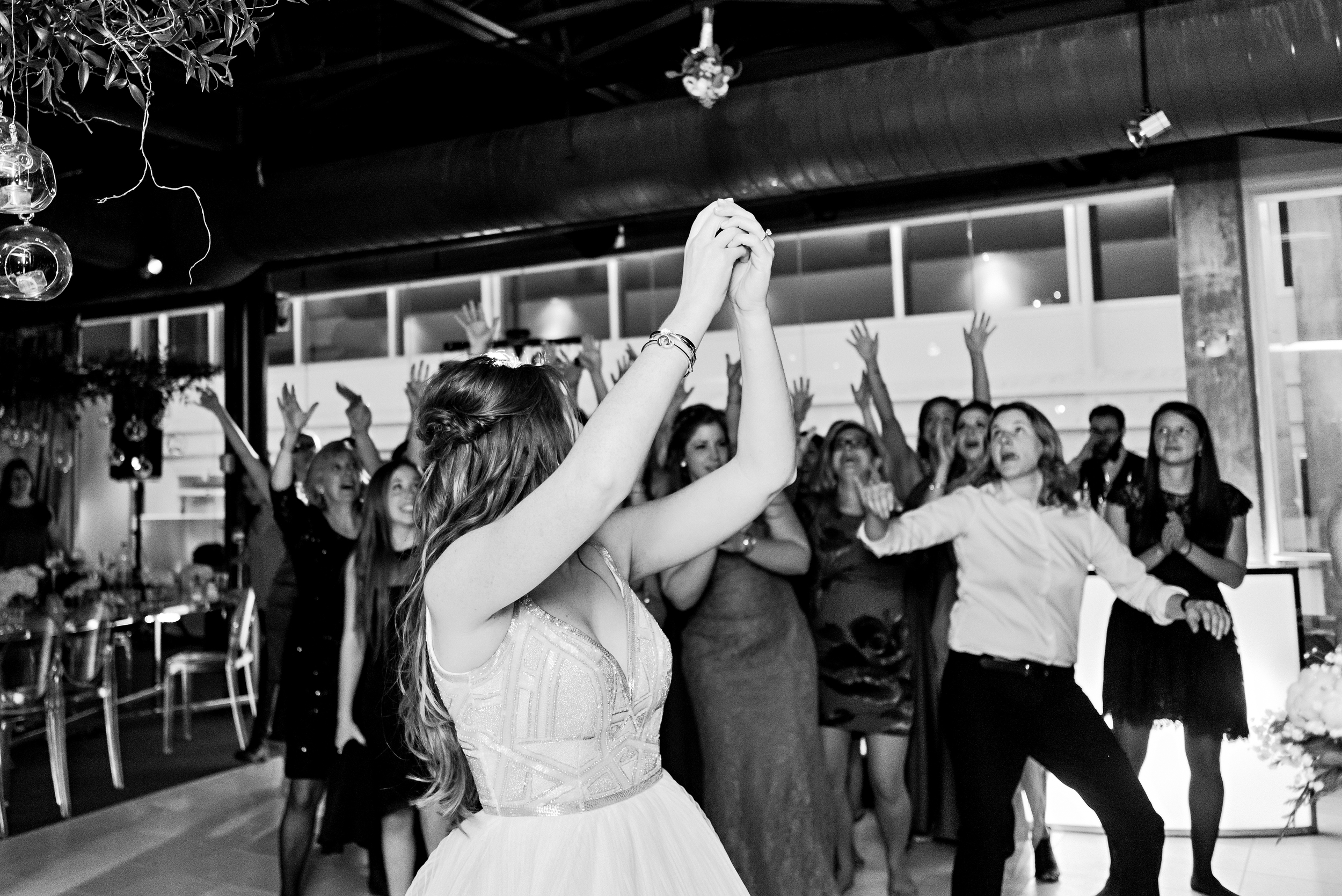 On of the brides doing her bouquet toss