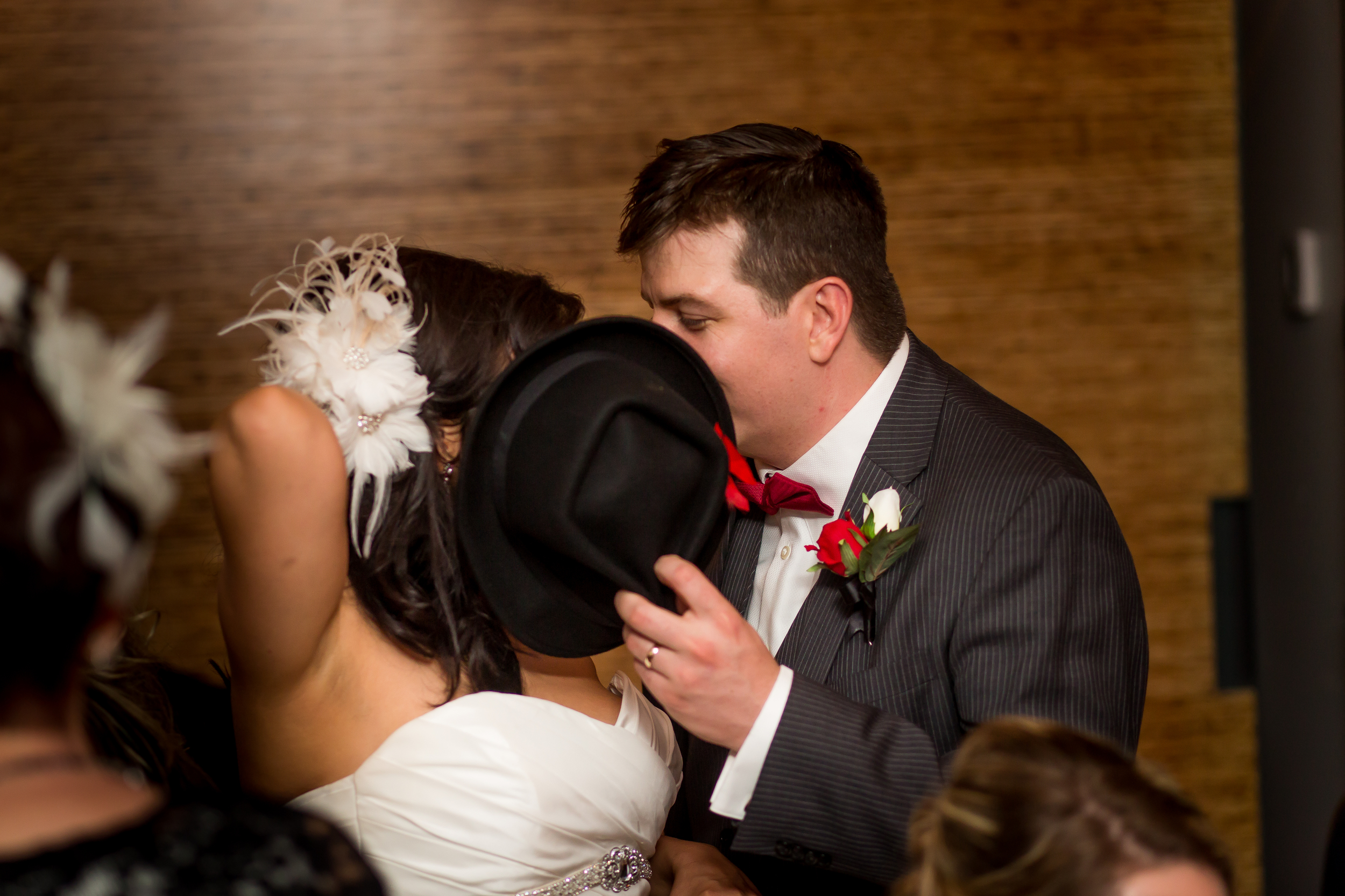 The bride and groom sneaking a kiss at their wedding reception