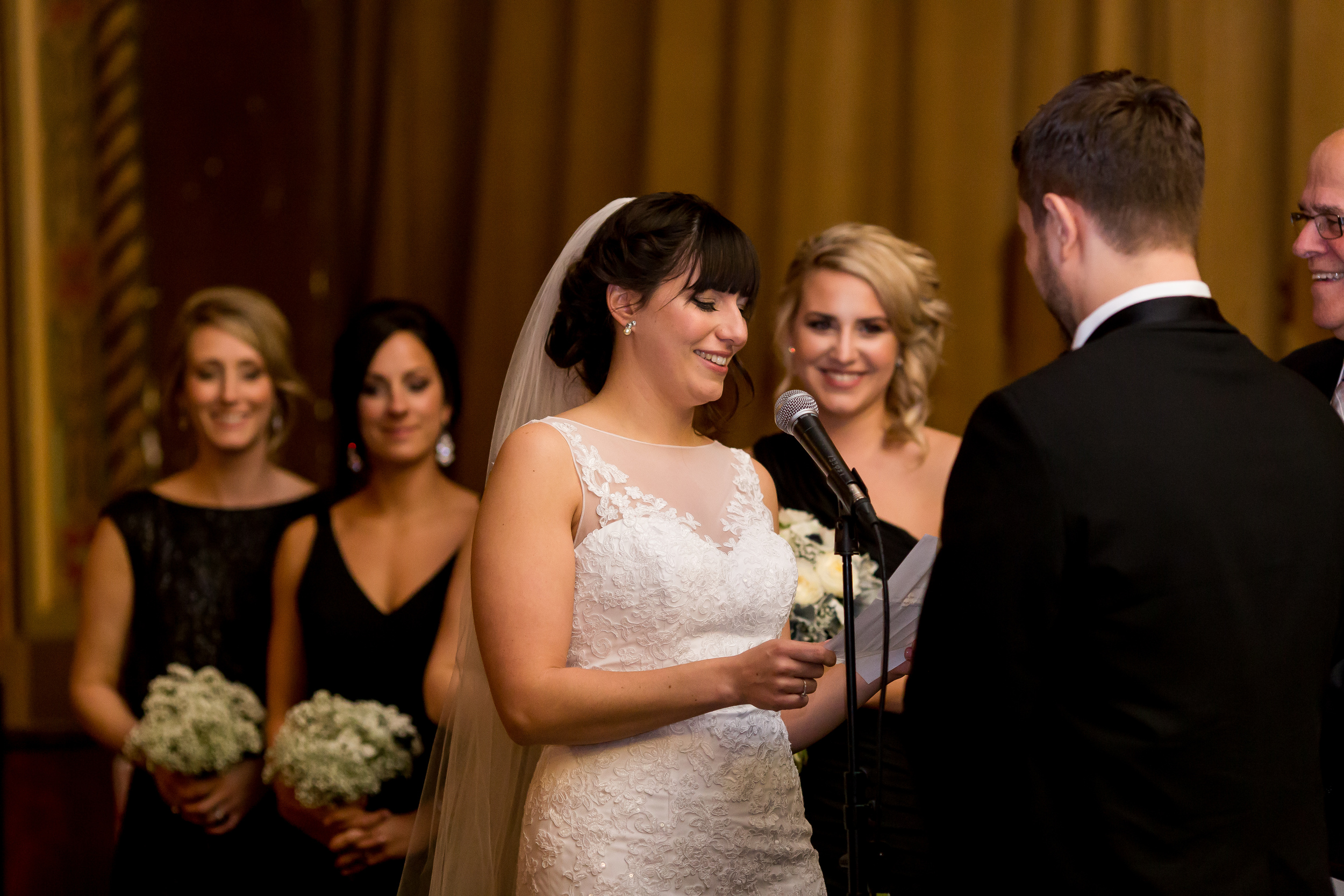 The bride reading her vows to the groom