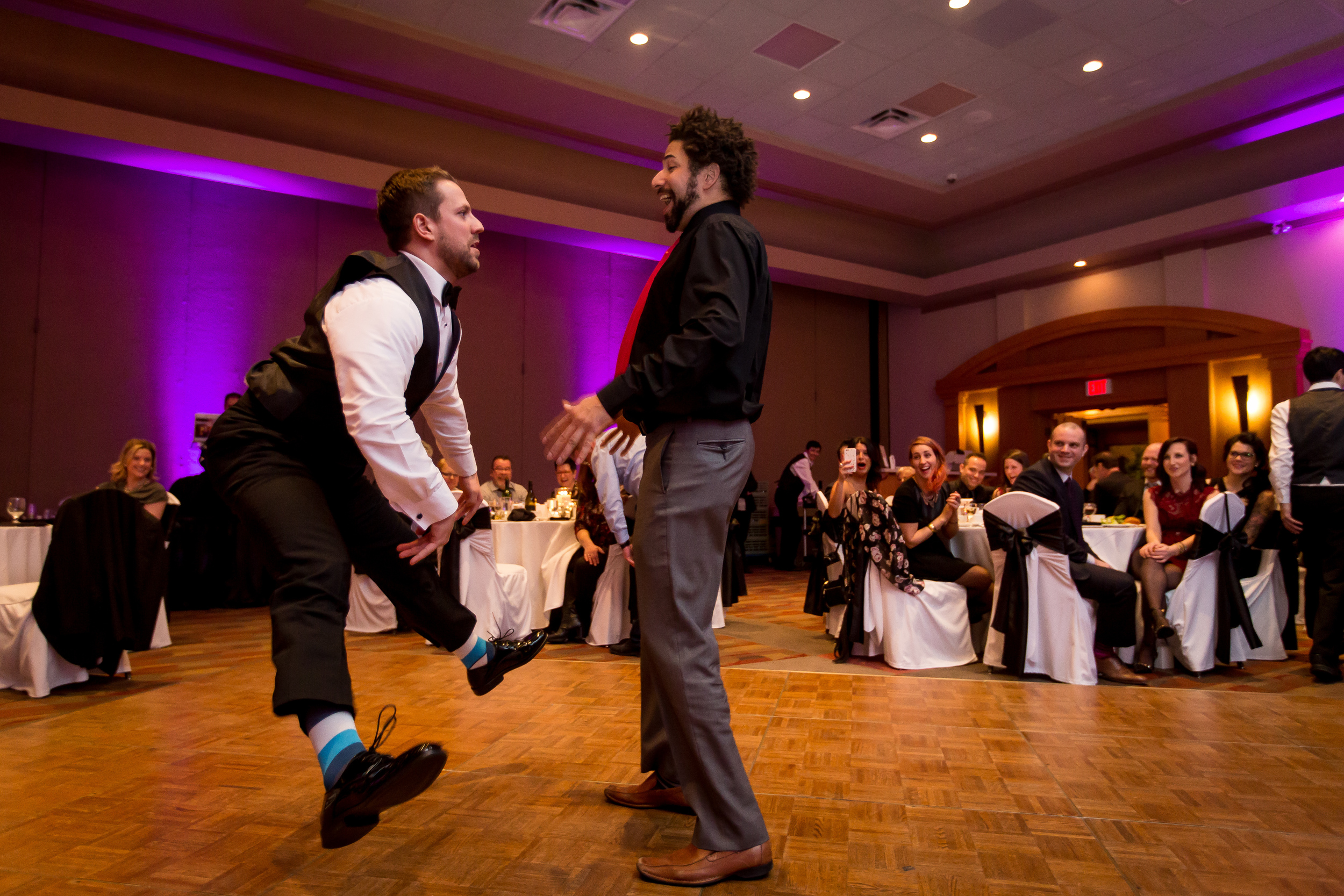 The groom and his friend having a dance-off
