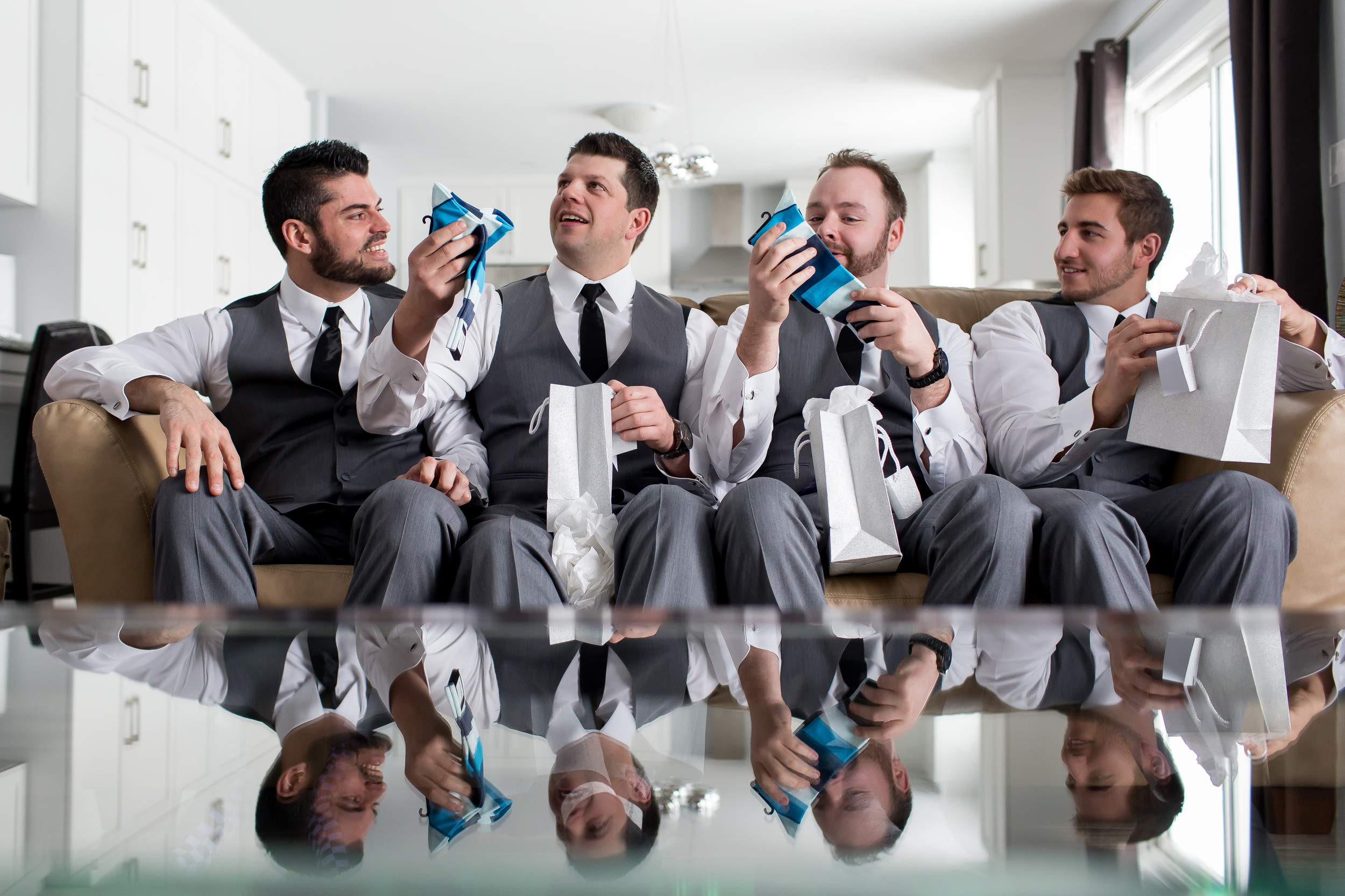 The groomsmen opening gifts