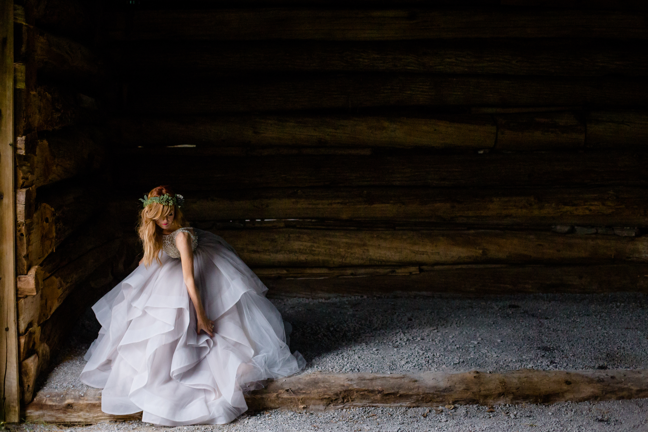 A photo of the bride displaying her wedding gown