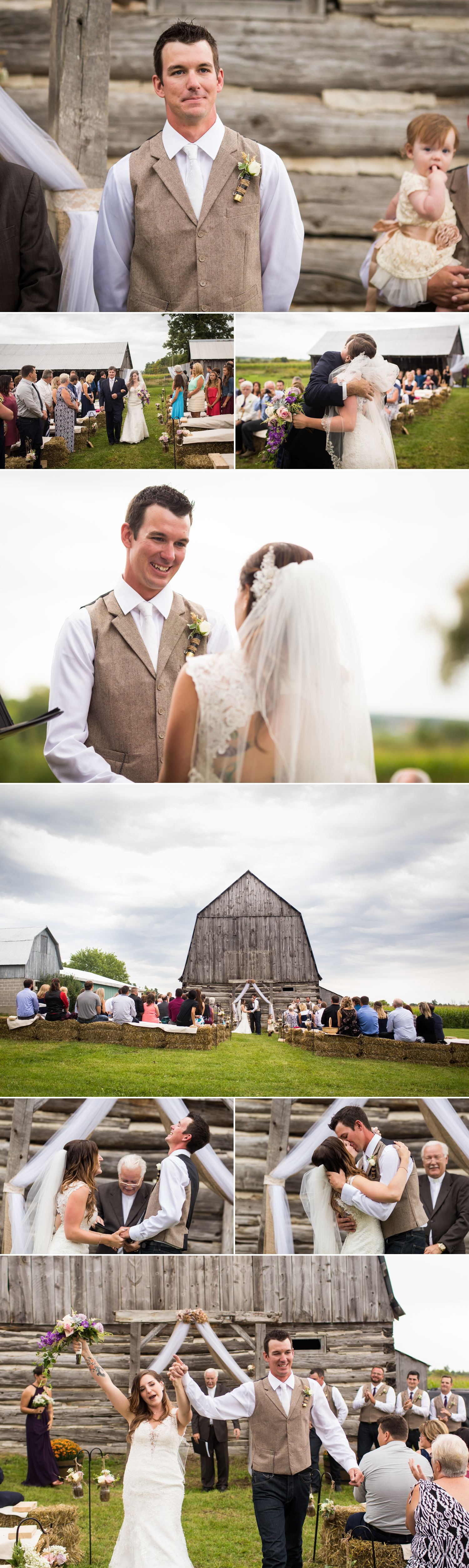A wedding ceremony taking place in front of the couples renovated rustic barn