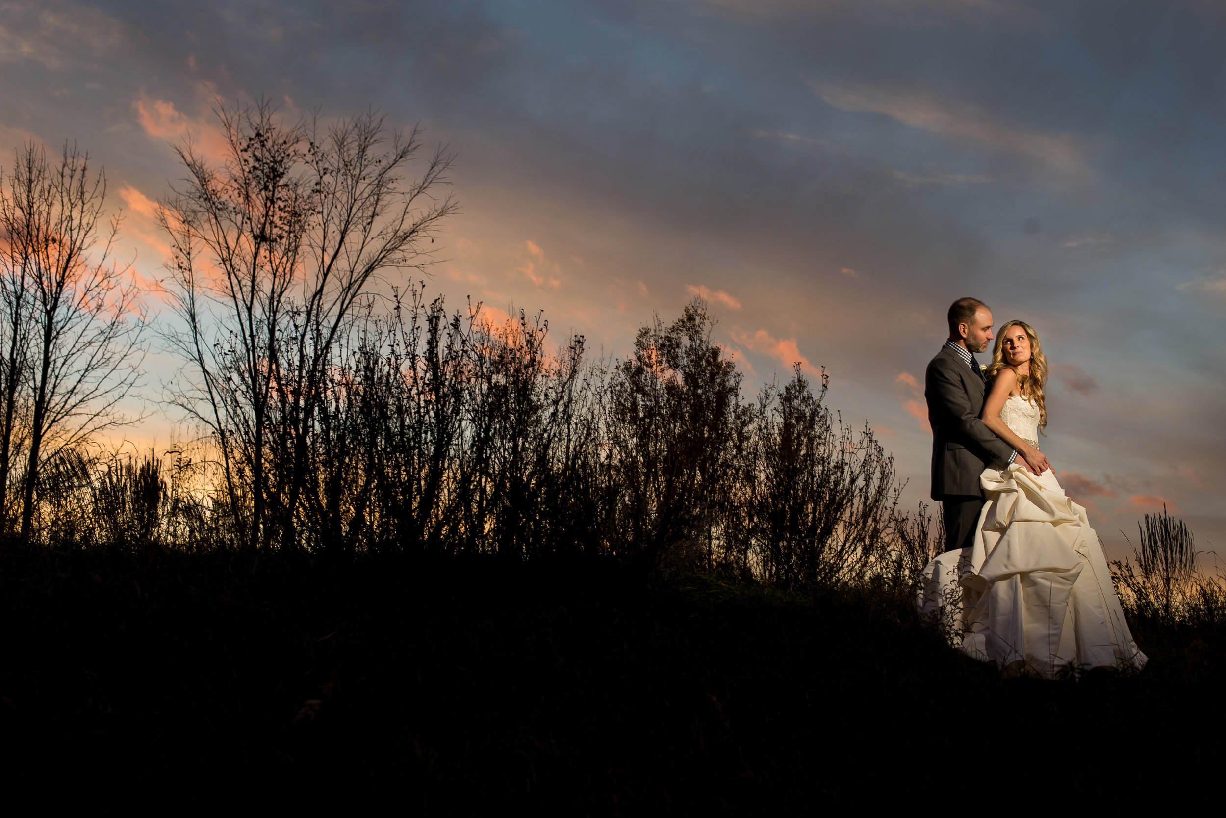 A portrait of the bride and groom outside at dusk at Stonefields