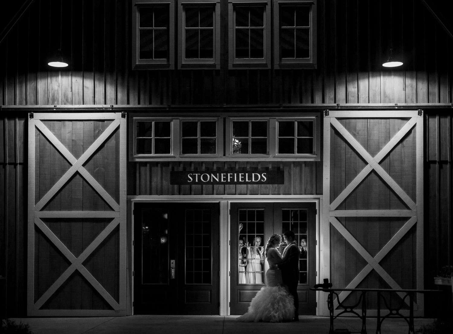 A night time portrait of the bride and groom outside the Stonefields Loft