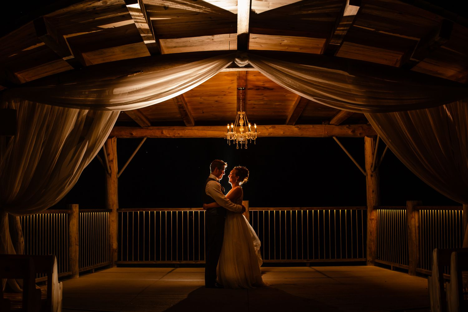 A night time portrait of the bride and groom outside at Le Belvedere