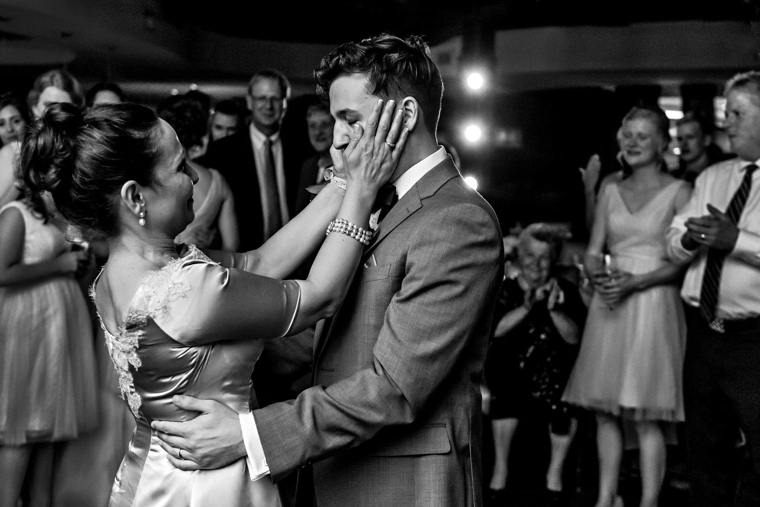 mother-and-son-have-a-moment-on-the-dance-floor-during-a-wedding-reception-at-a-lago-wedding-ottawa.jpg