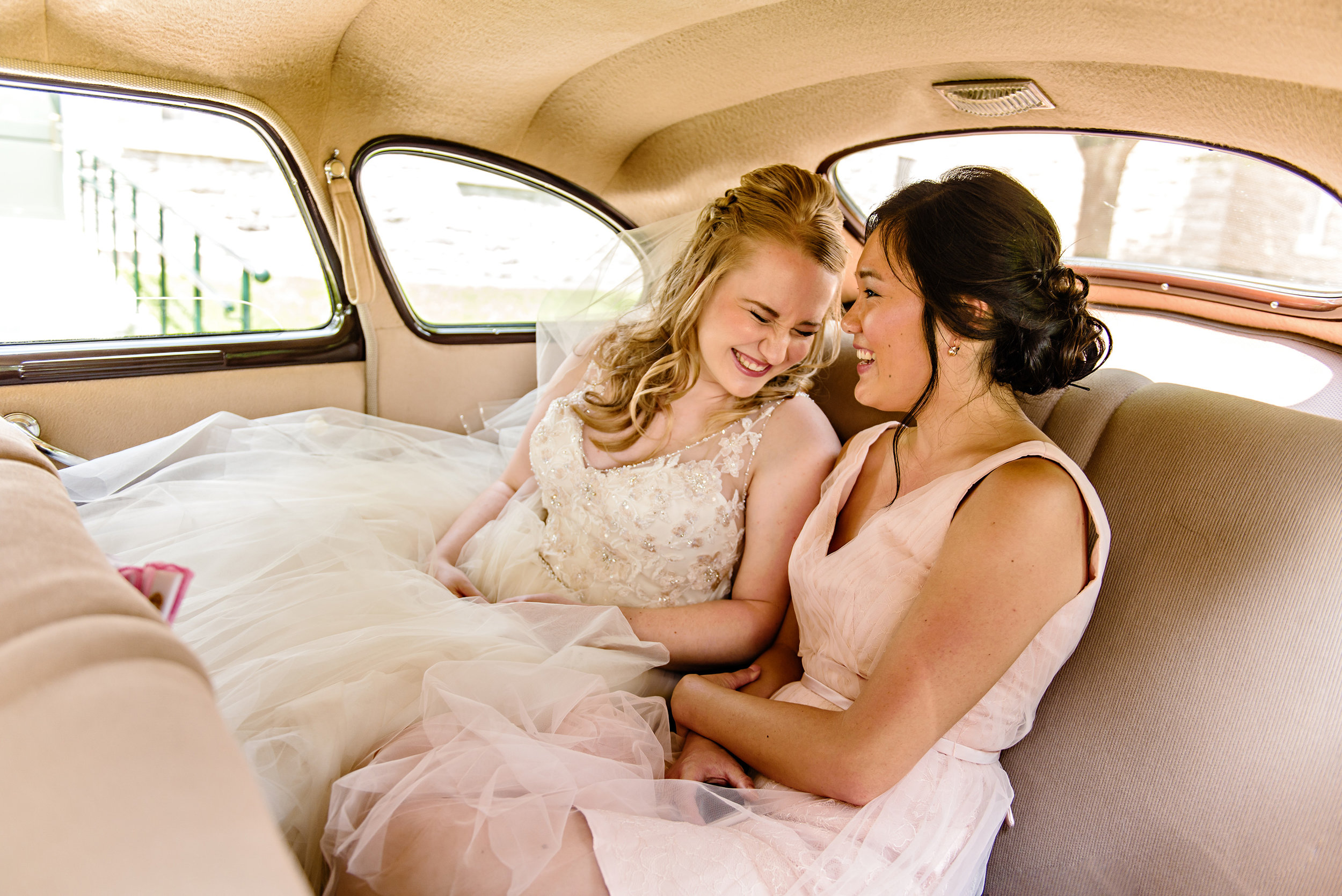 bride-and-bridesmaid-have-a-moment-in-the-limo-before-a-st-patricks-wedding-in-richmond-ontario.jpg