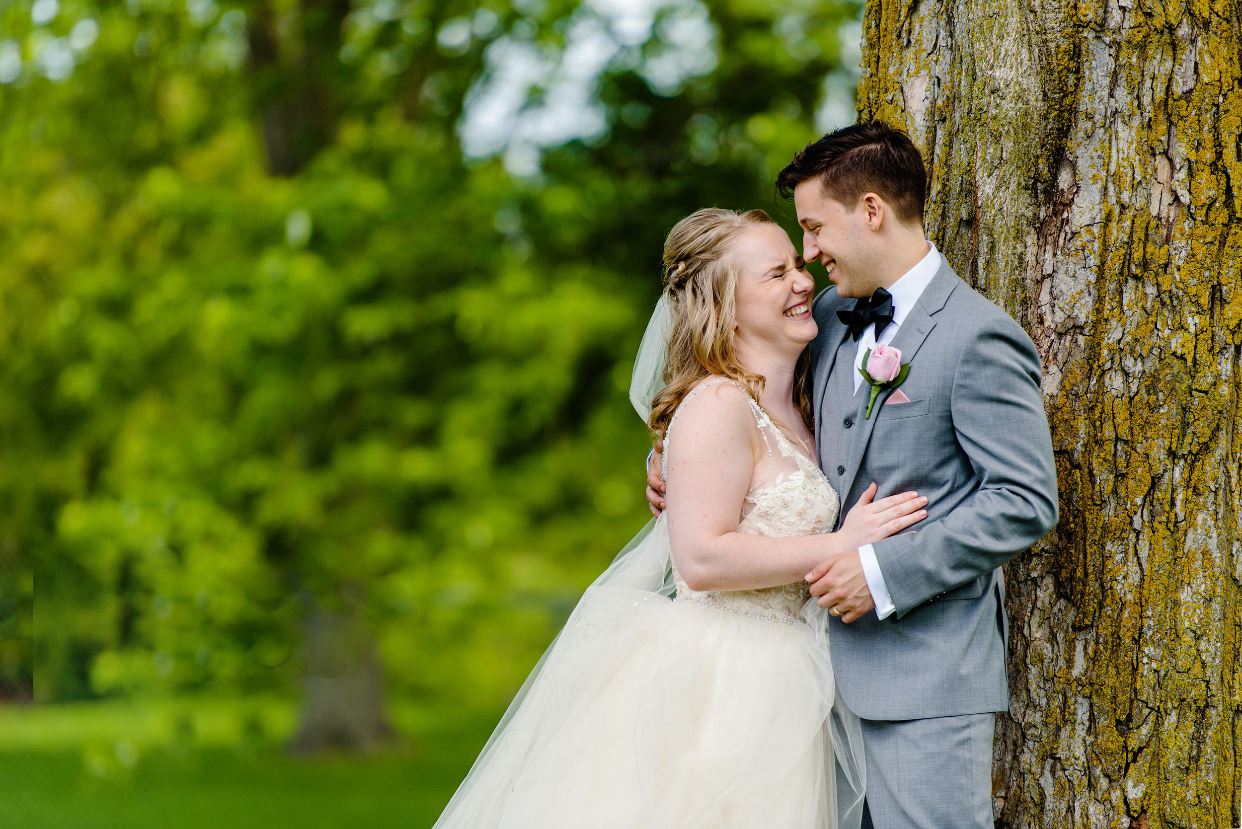 bride-and-groom-have-a-funny-moment-at-major-hill-park-in-ottawa.jpg