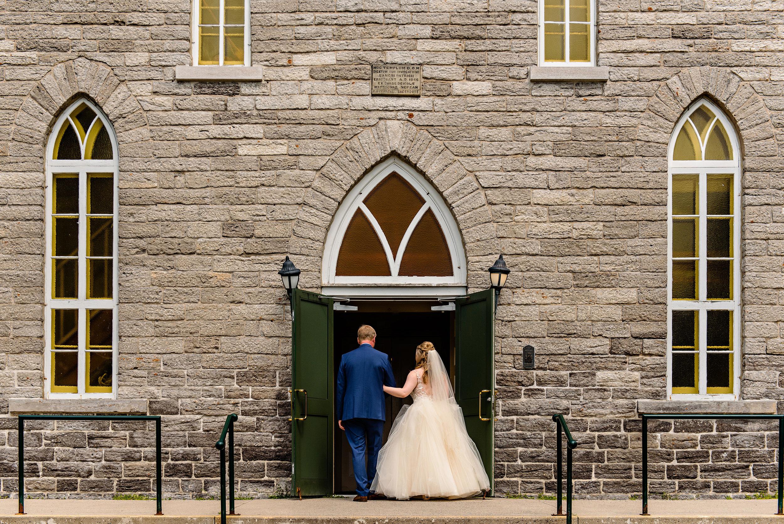bride-and-father-enter-patricks-church-at-a-wedding-in-richmond-ontario.jpg