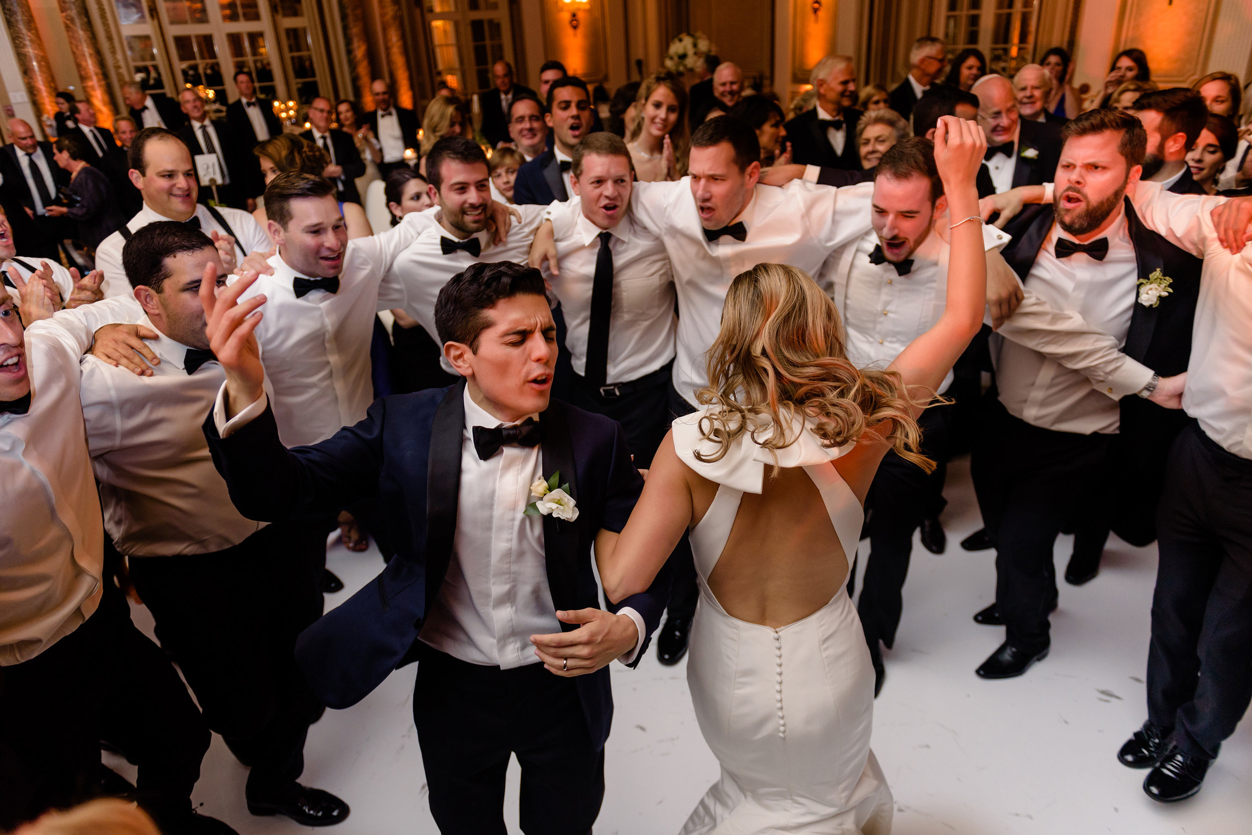 bride-and-groom-horah-dance-during-a-wedding-reception-at-a-fairmont-chateau-laurier-in-ottawa.jpg