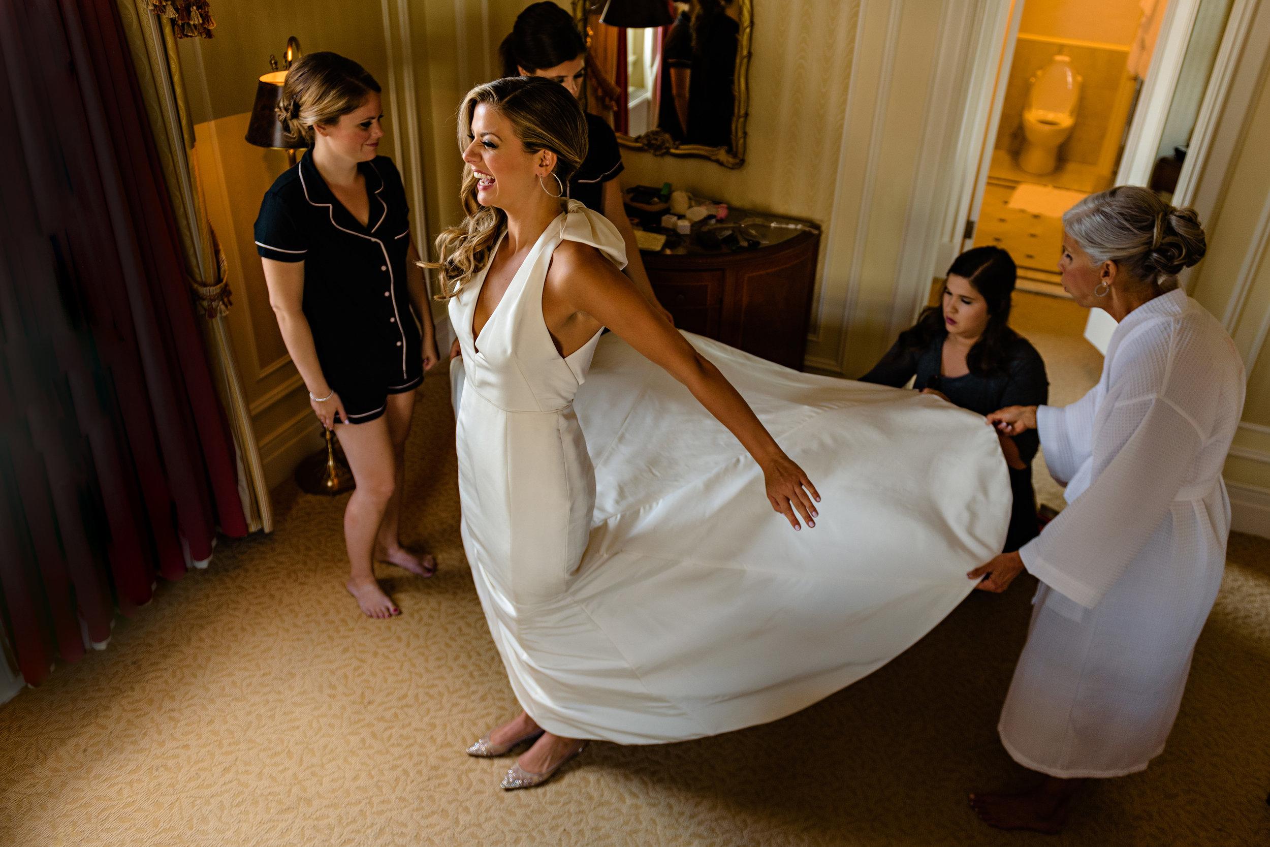 bride-gets-into-dress-at-a-fairmont-chateau-laurier-wedding-ottawa.jpg
