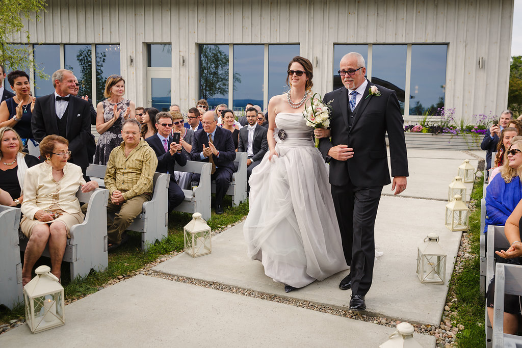 bride walking down the isle at le belvedere near wakefield quebec