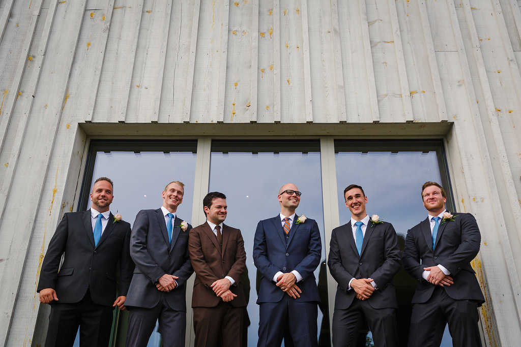 photograph of a groom and his groomsmen