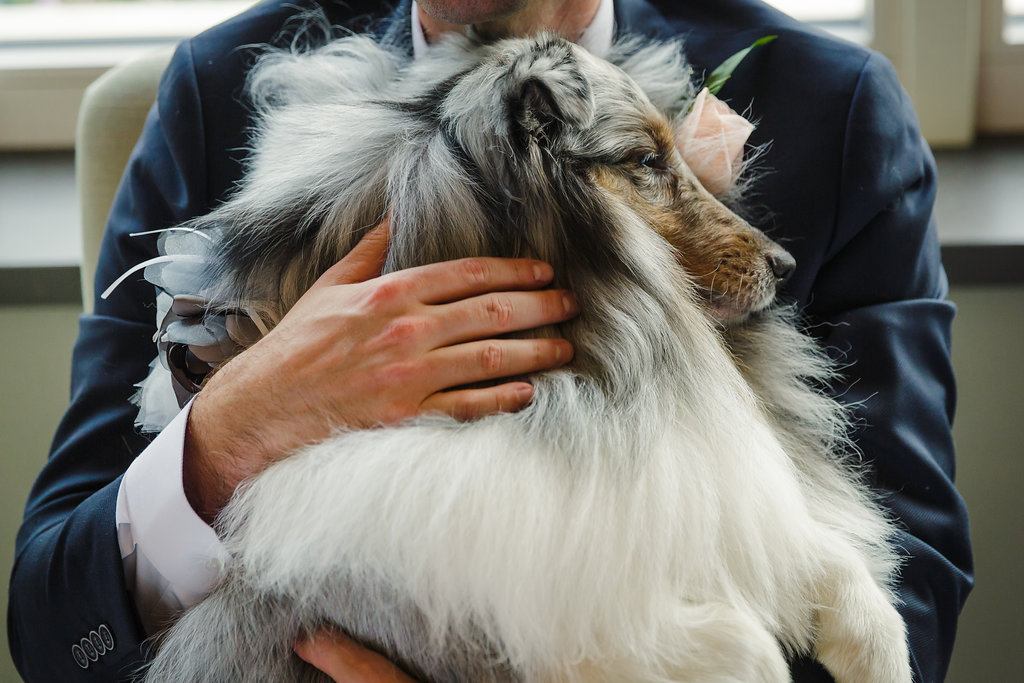 groom and his pet dog