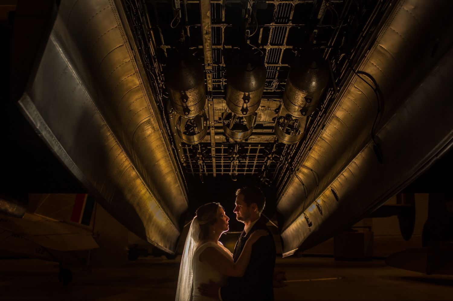 A night time portrait of the bride and groom taken inside the Canadian Aviation and Space Museum in downtown Ottawa